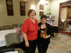 Carol receives Barbershopper of the Year and 10 year pin